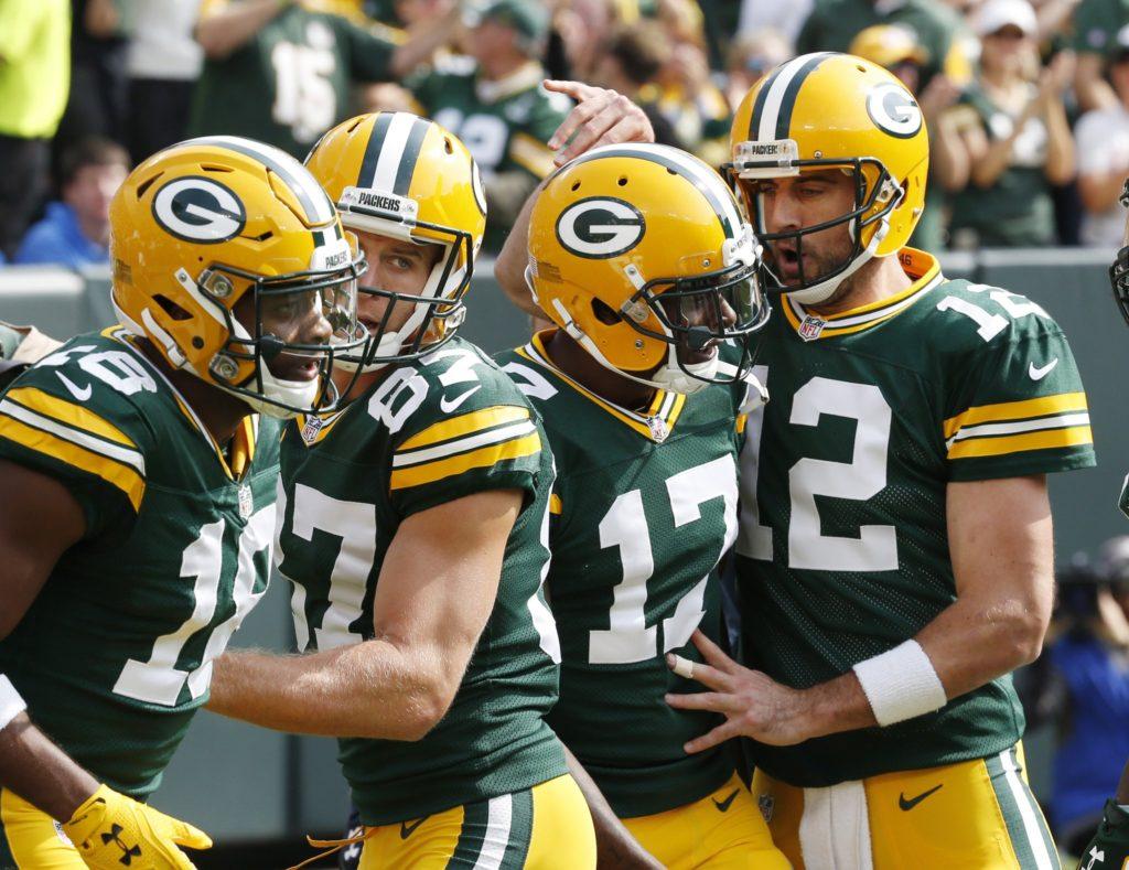 Jogadores dos Packers comemoram a vitória sobre os Lions